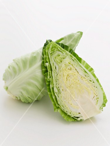 A pointed cabbage, cut in half