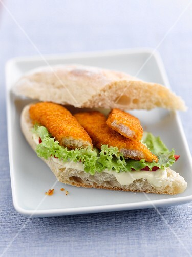 A fish finger sandwich with lettuce and mayonnaise