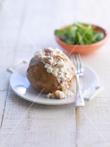 A baked potato with cottage cheese