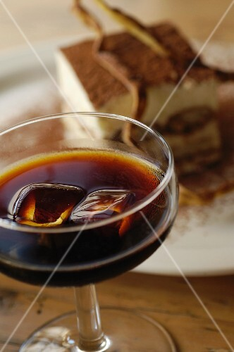 A glass of Tia Maria (coffee liqueur) and tiramisu