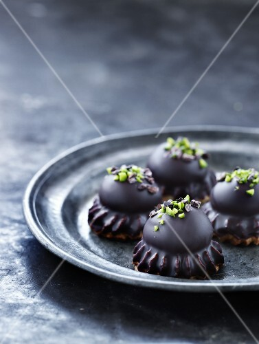 Chocolate meringues topped with pistachios