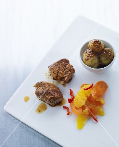 Beef fillet with sesame potatoes and orange and carrot salad