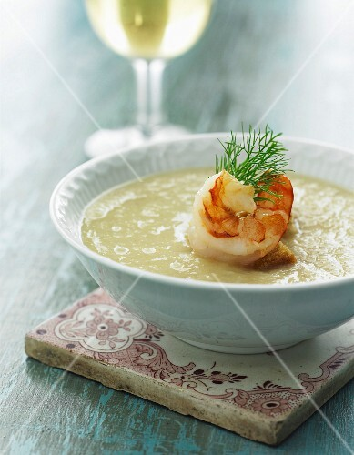 Cream of potato soup with prawns and dill