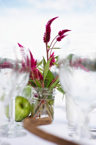 An Outdoor Table with Wildflowers in a Jar