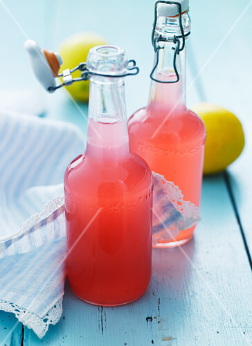 Sweet rhubarb juice in flip-top bottles
