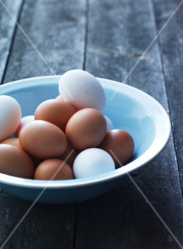 A bowl of white and brown eggs
