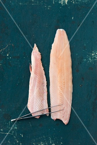 Char fillets with a pair of tweezers