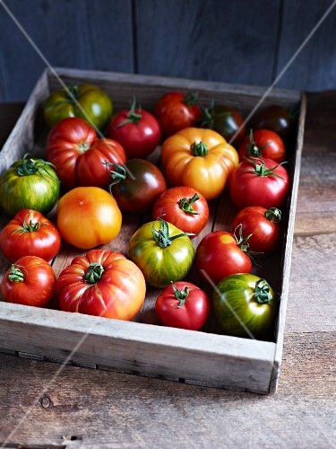 A crate of heirloom tomatoes