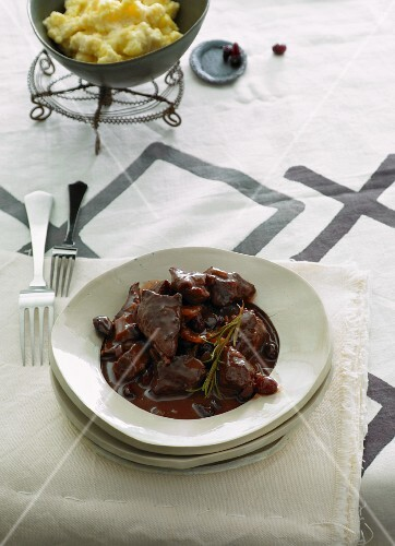 Lamb goulash with port wine and cranberry sauce