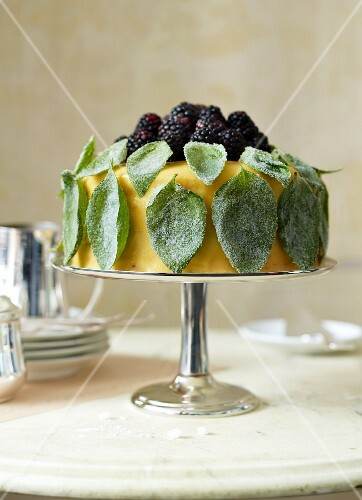 An orange and basil cake topped with blackberries