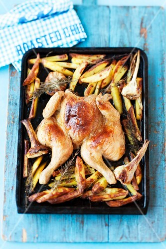 Roast chicken with chips and rosemary