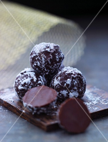 Chocolate pralines dusted with icing sugar for Christmas