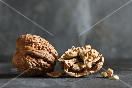 Whole walnuts and half a walnut