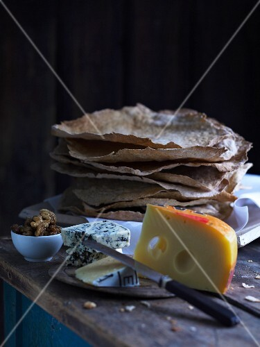 An arrangement on various cheeses and unleavened bread