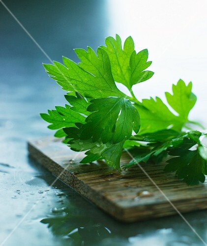 Parsley on a wooden board