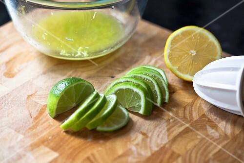 Half a lemon and lime slices