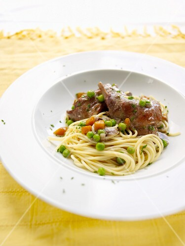 Rabbit with noodles, peas and carrots