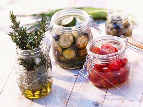 Preserved vegetables and herbs in jars