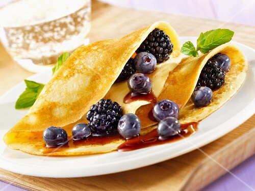 Pancakes with blueberries and blackberries