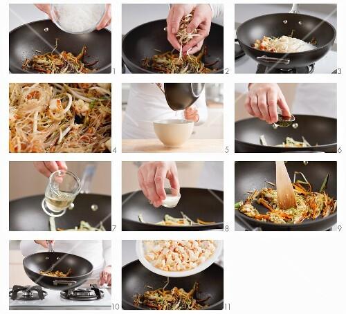 Filling for spring rolls (vegetables, glass noodles and prawns) being made