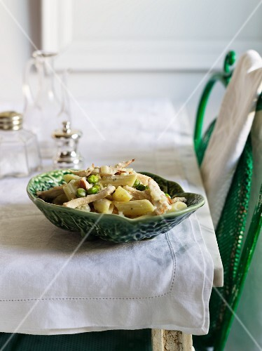 Penne pasta with chicken breast and peas
