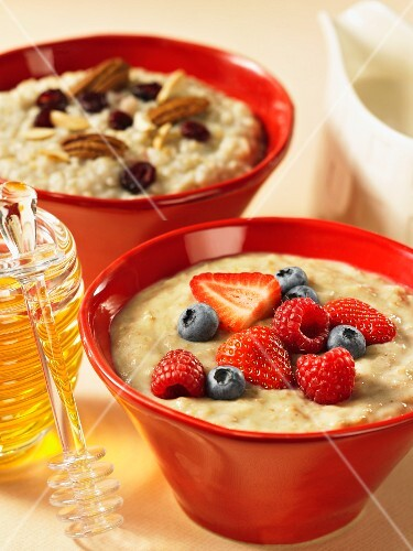 Wheat porridge with fresh berries, oats with nuts and honey