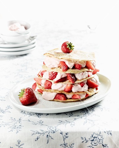 A pancake cake with strawberries and coconut quark