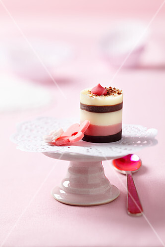 Pralines and a lace doily on a mini cake stand