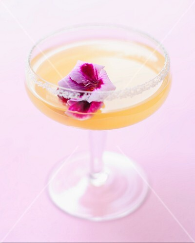 A lemon drink decorated with a flower