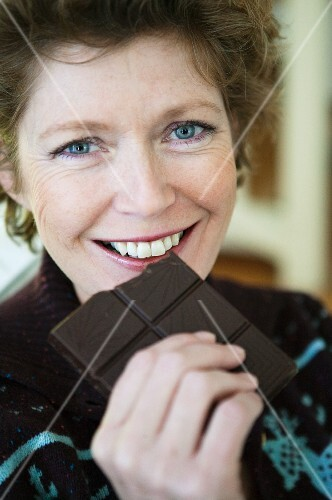 A woman eating chocolate