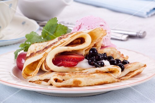 Pancakes with berries and ice cream