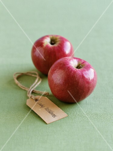 Two Lady Williams apples with a label