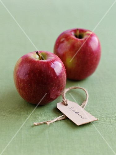 Two Sundowner apples with a label
