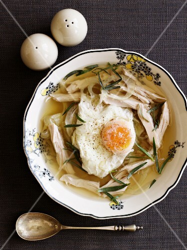 Chicken soup with a poached egg