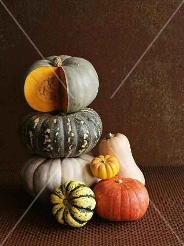A stack of various pumpkins