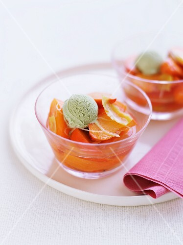 Peach compote with pistachio rice