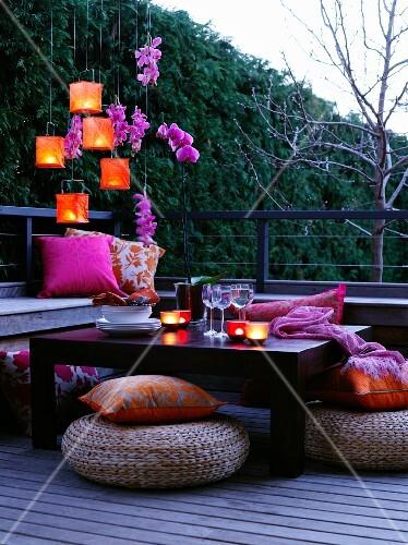 A table laid on a terrace at dusk