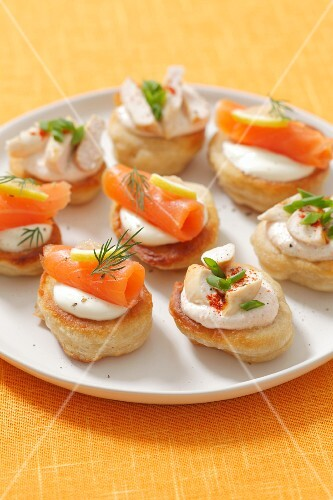Blinis topped with smoked salmon and chicken