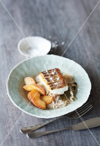 Fried zander on a bed of sauerkraut with caramelised apples