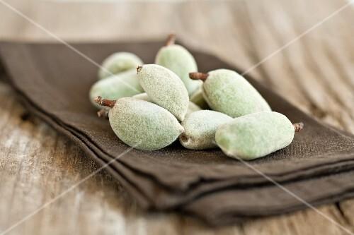 Fresh almonds on a linen napkin