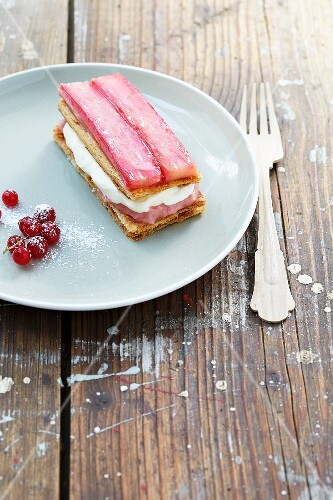 A slice of rhubarb cream cake with red currants