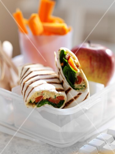 Hummus and tomato wraps for lunch