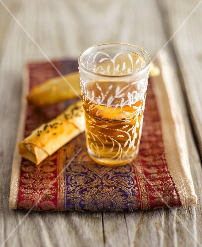 Black tea in a glass with yufka dough rolls (Orient)