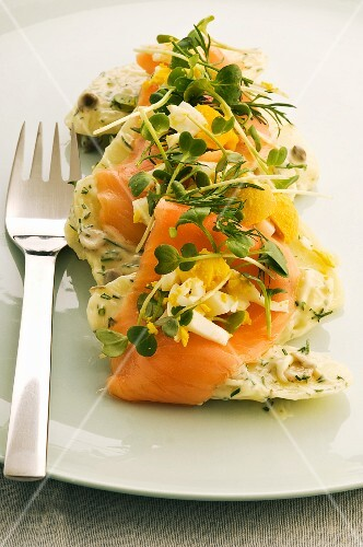 Potato salad with smoked salmon, egg and herbs