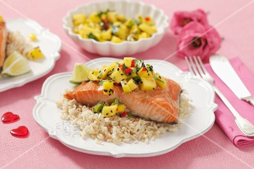 Salmon fillet on rice with mango-chili salsa