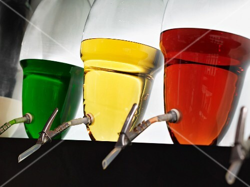 Spirits in assorted colors in glass containers: cream liqueur, peppermint liqueur, cognac, brandy