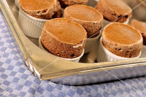 Chocolate souffles on a baking tray