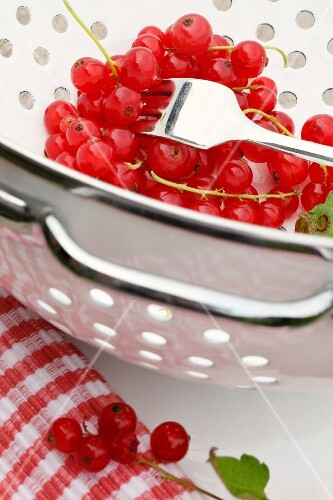 Red currants in a colander