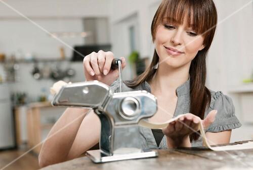 A woman making pasta