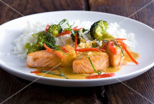 Grilled salmon with coconut sauce, broccoli and rice
